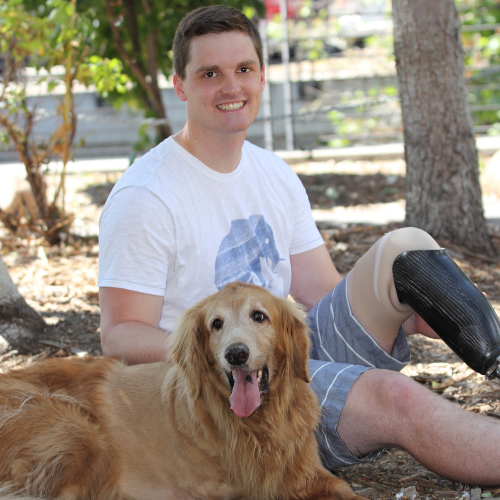 Man with a prosthetic and dog for Limb Loss Awareness Month